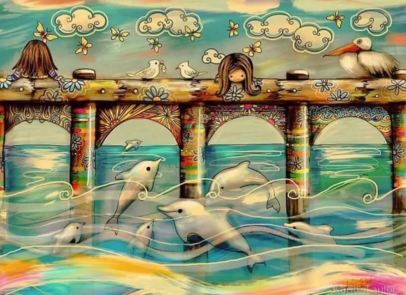 Niño en un puente mirando delfines